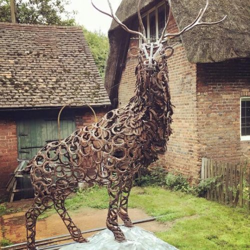large stag sculpture looking at camera