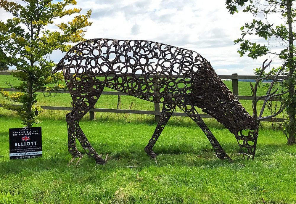 Horseshoe Stag Sculpture Grazing On Grass