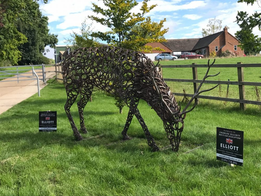 Horseshoe Stag Sculpture Next To Driveway