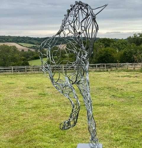 Half Horse Sculpture Standing On Black Plinth