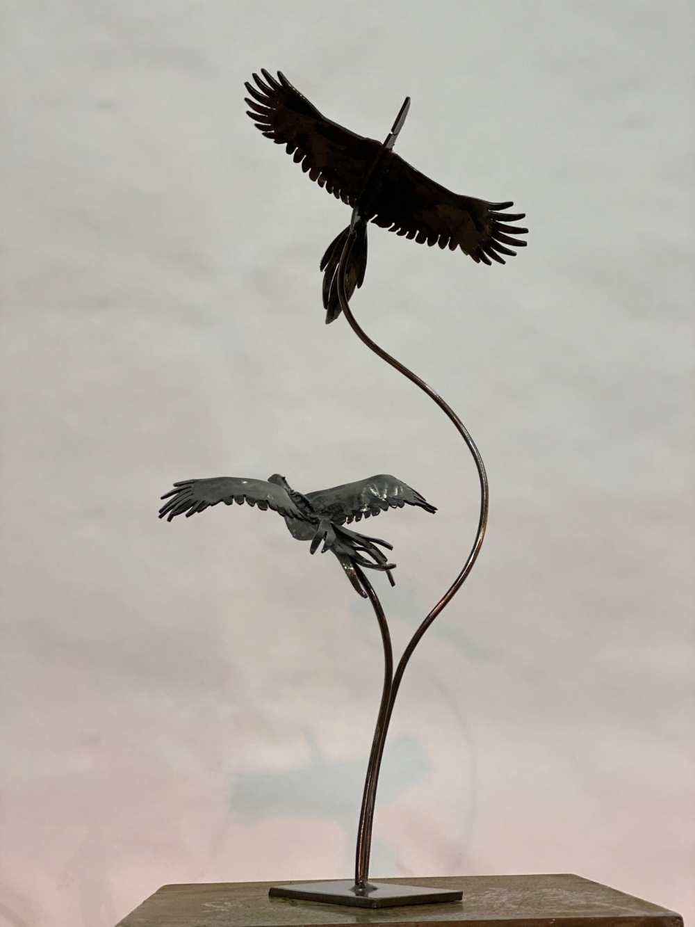 Two Birds Sculpture On Table