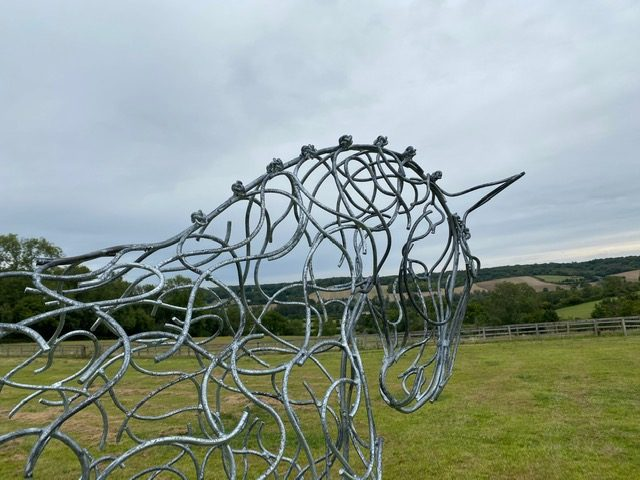 side view of half horse sculpture