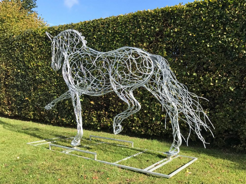 Long Tail Of Silver Horse Sculpture