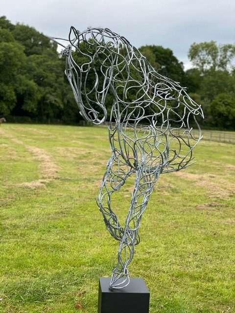 silver half horse design in field