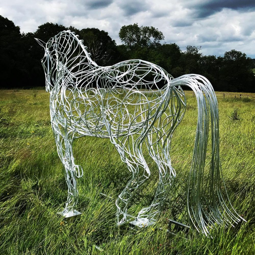 Tail Of Horse Trotting Sculpture