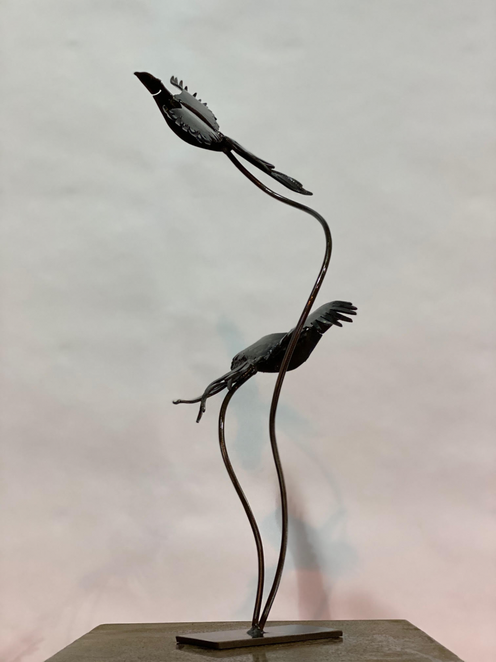 Birds Sculpture With Cloudy Background