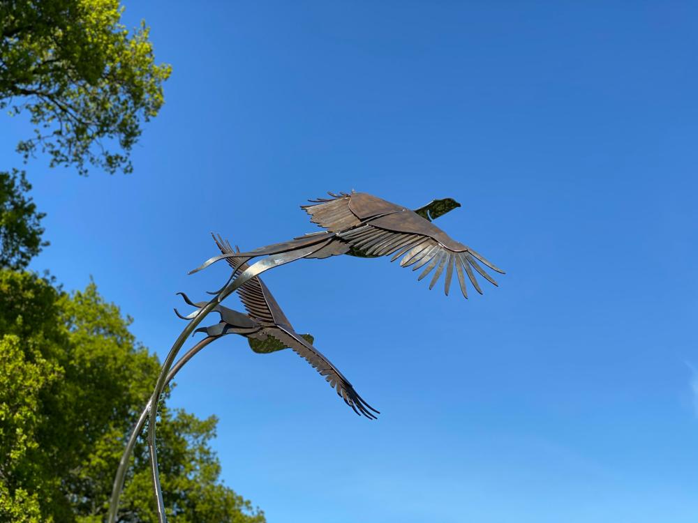 rustic birds flying sculpture