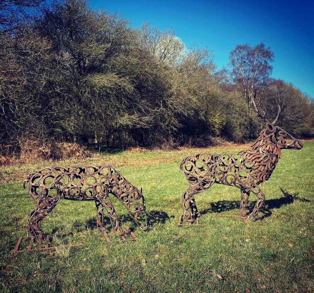 Stag and Doe Sculpture In Wooded Area