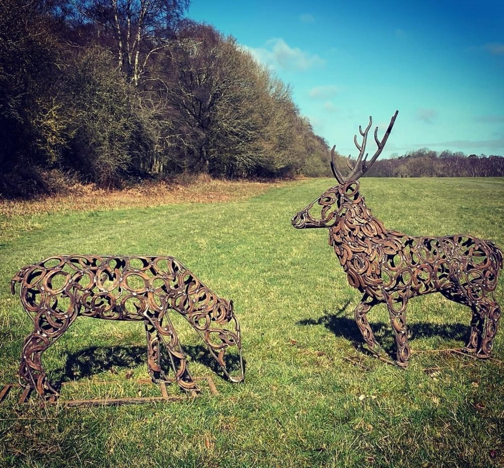 Stag and Doe Sculpture In A Field