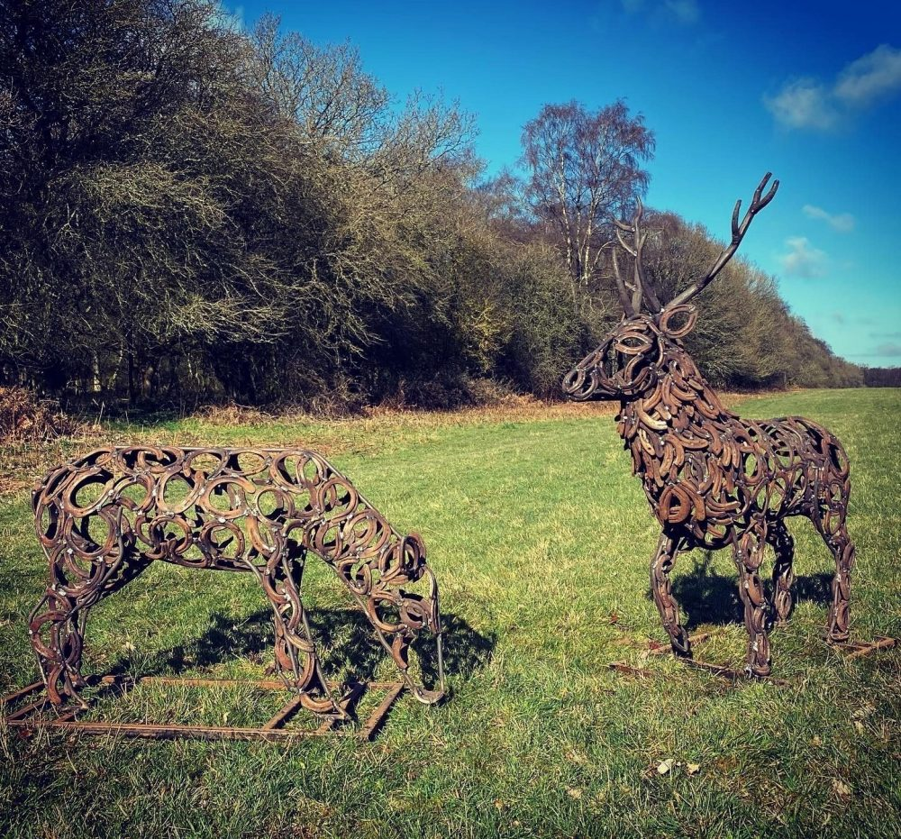 Stag and Doe Sculptures Grazing