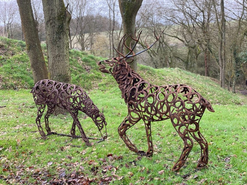 Stag and Doe Sculptures In Woods