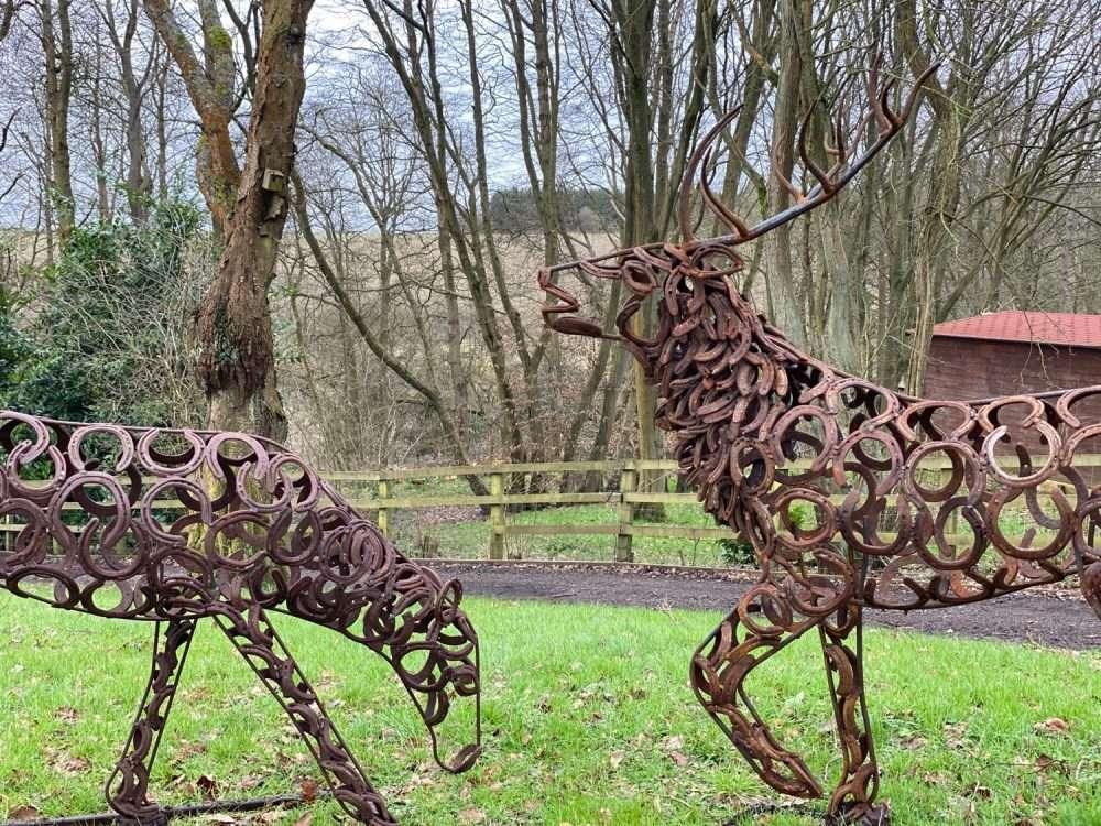 Stag and Doe Sculptures Together