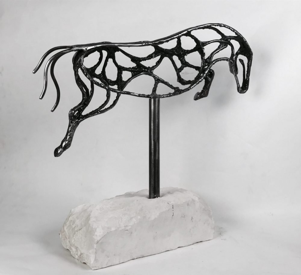 Abstract Jumping Horse Sculpture Against White Background