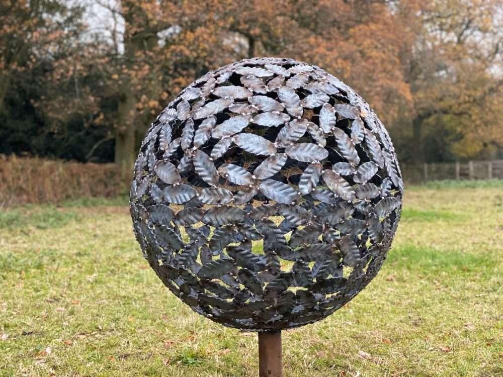 Beech Leaf Sphere Sculpture In A Field
