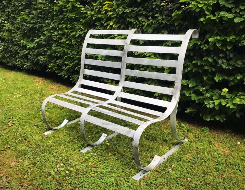 Contemporary Handmade Metal Bench In A Garden