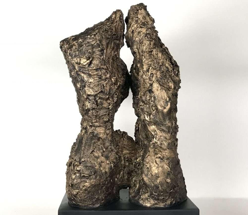 textured bronzed women's body sculpture