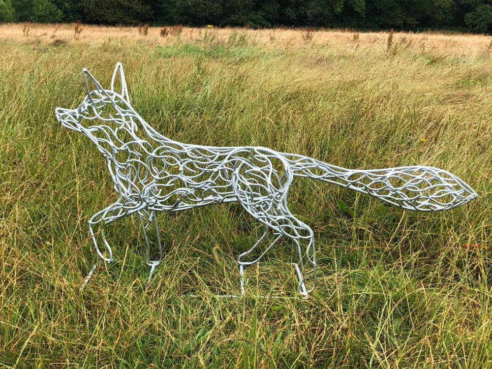 Side View Of Silver Fox Sculpture