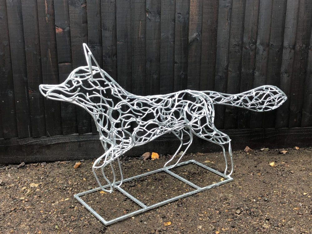 Side View Of Silver Galvanised Fox Sculpture