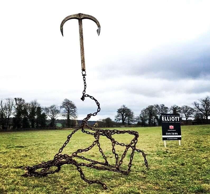 Gravity Anchor Sculpture Next To Elliott Of London Sign