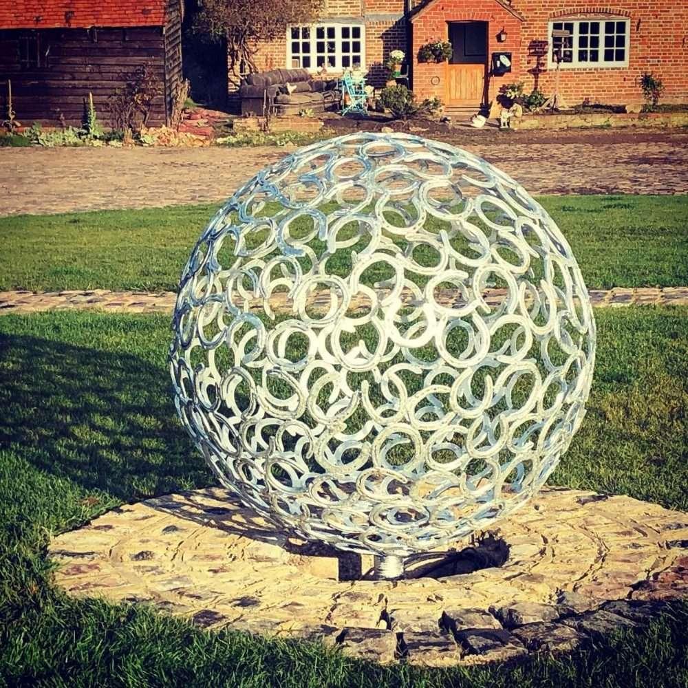 Horseshoe Sphere Sculpture At Dusk