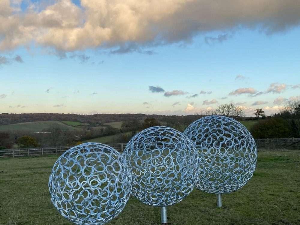 Three Horseshoe Sphere Sculptures