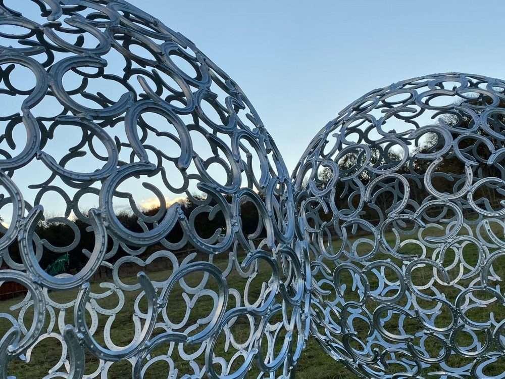 Two Horseshoe Sphere Sculptures