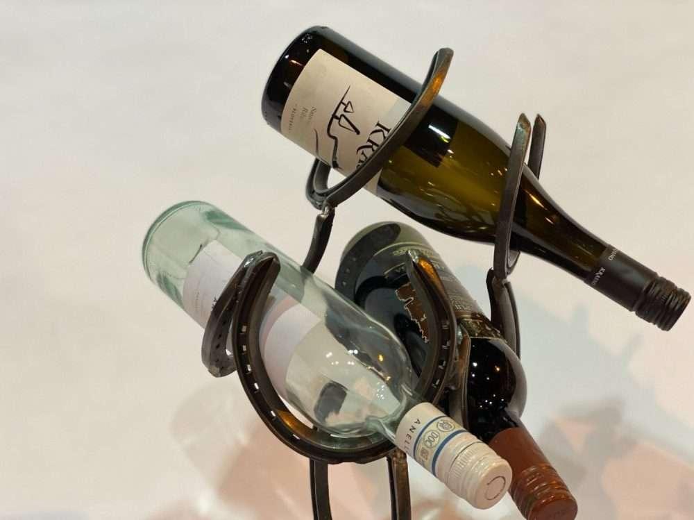 Close Up Of Black Horseshoe Wine Rack