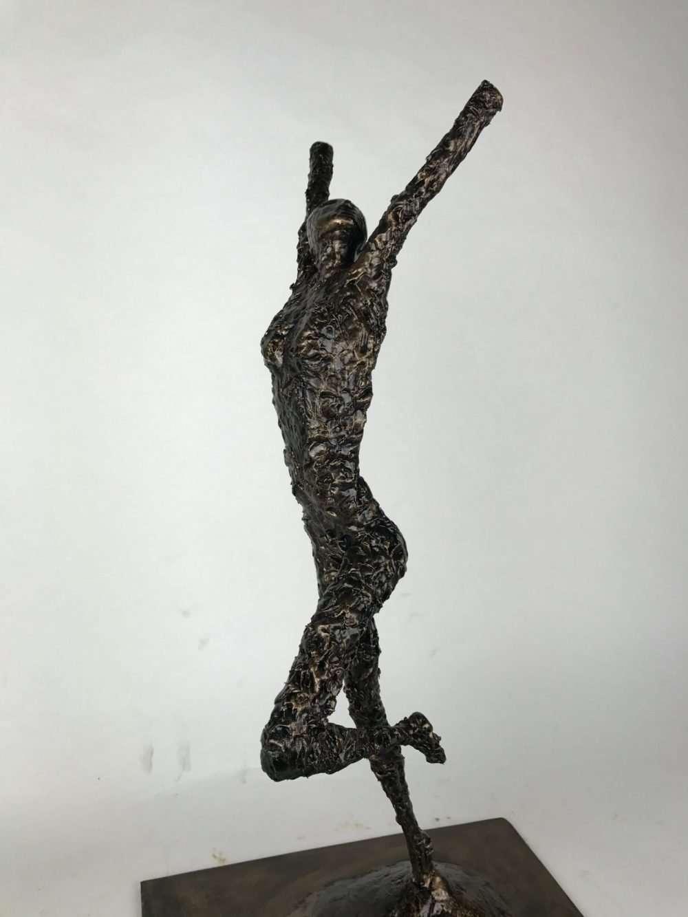 Side View Of Release Bronze Sculpture