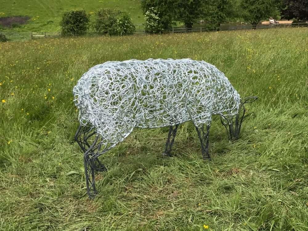 Sheep Sculpture Grazing In A Field