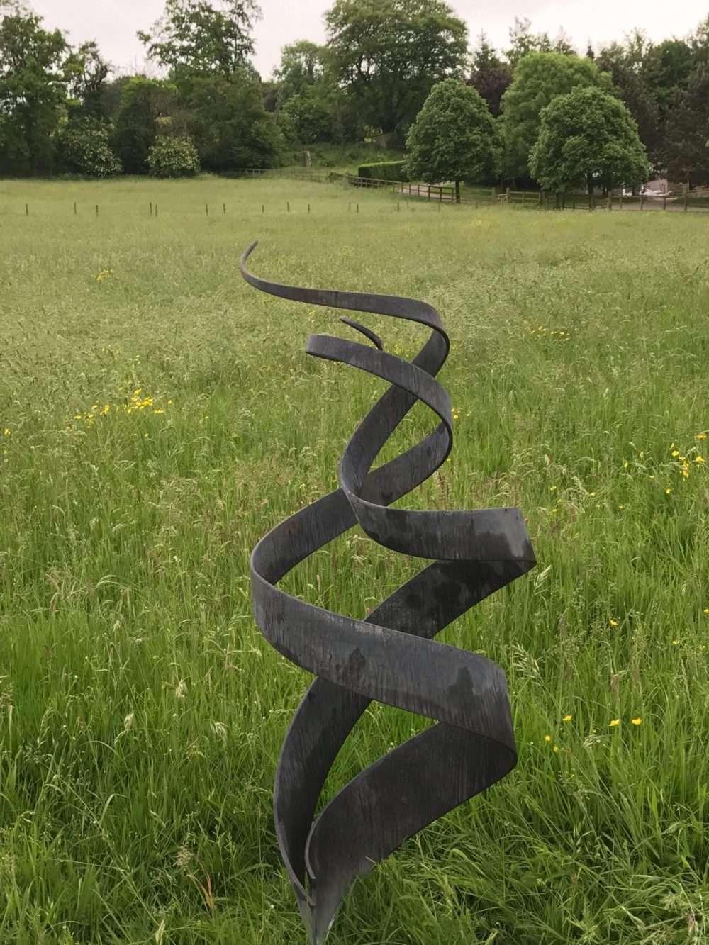Spiral Abstract Sculpture At Dusk