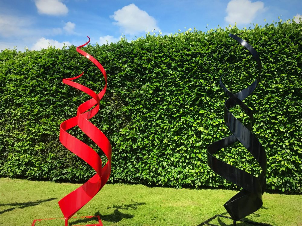 Shiny Red And Black Spiral Abstract Sculpture