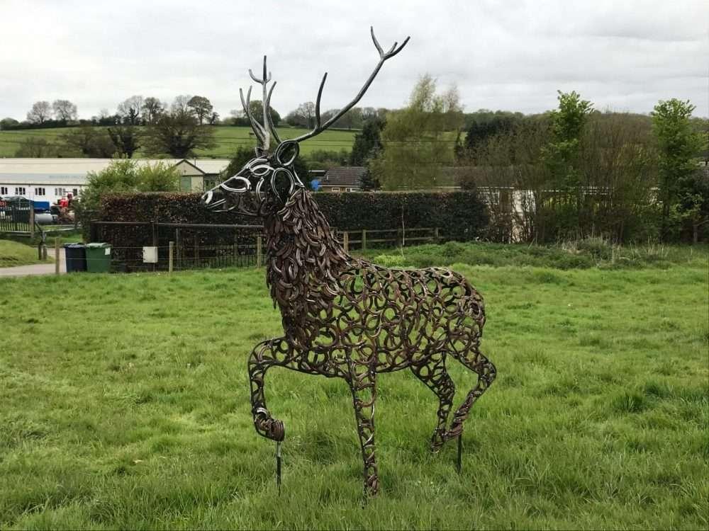 Strutting Stag Sculpture in field