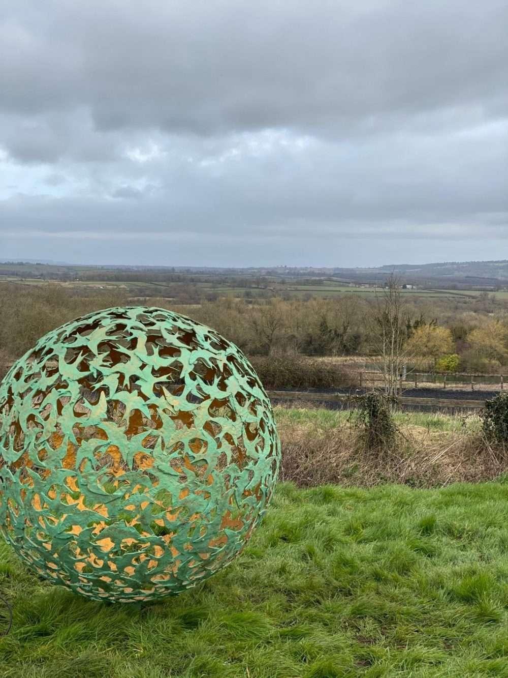 Swift Sphere Sculpture in a field