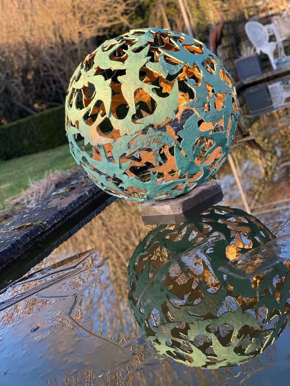 Swift Sphere Sculpture in pond