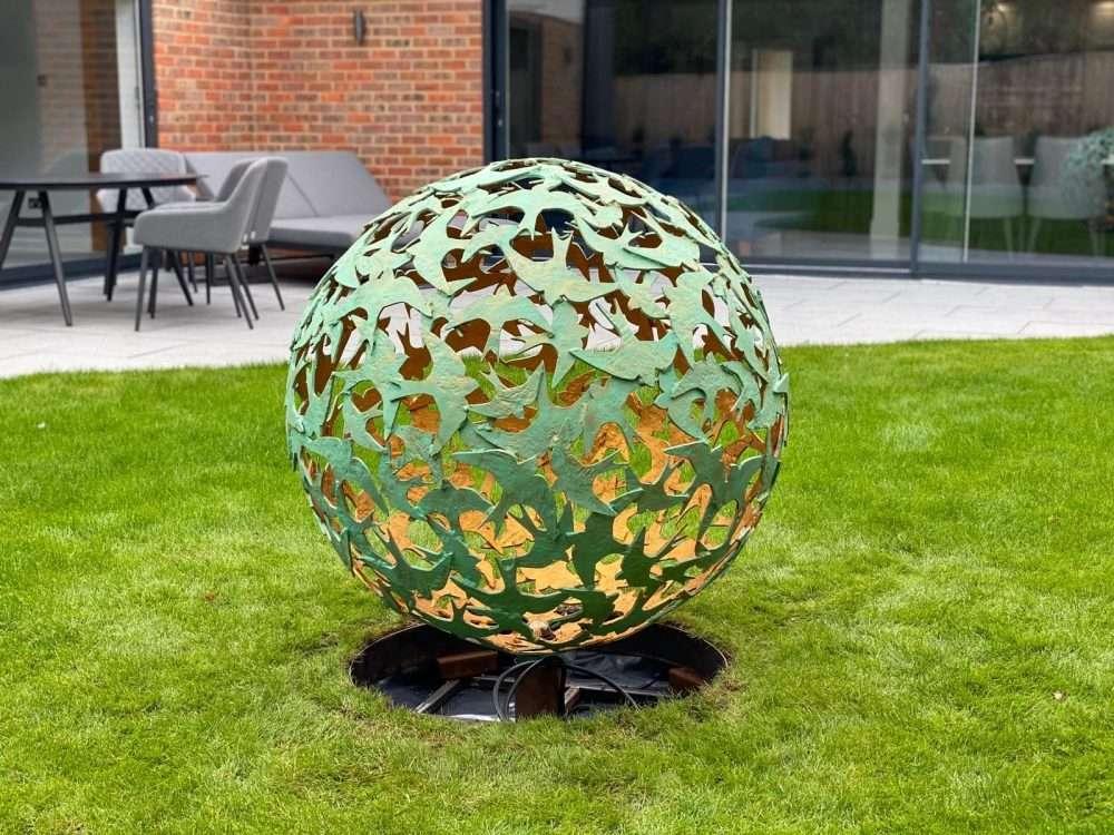 Swift Sphere Sculpture In Domestic Garden