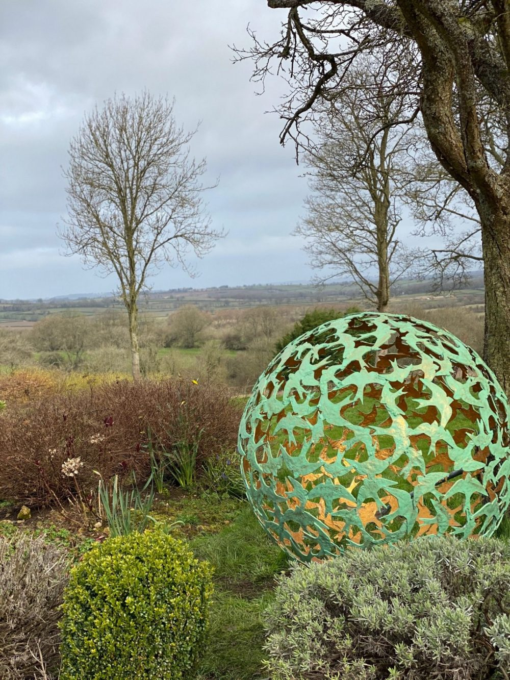 Swift Sphere Sculpture in wooded area