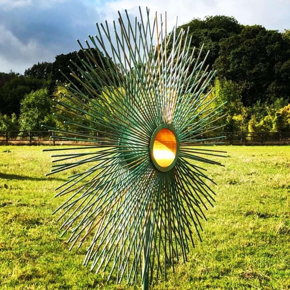 Verdigris Gold Peacock Sculpture In A Field