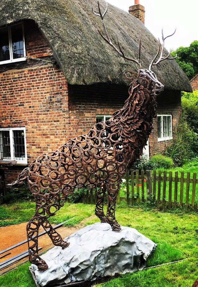 Large Stag Sculpture Climbing A Rock