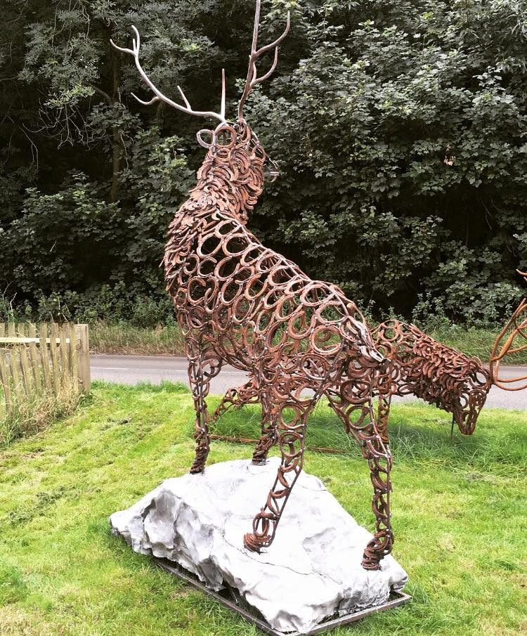 Back Of Stag Sculpture Standing On Rock