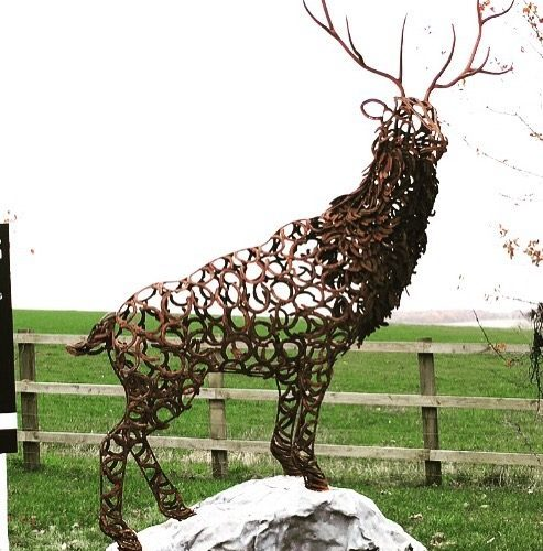 Bronzed Horseshoe Stag Sculpture In Large Field