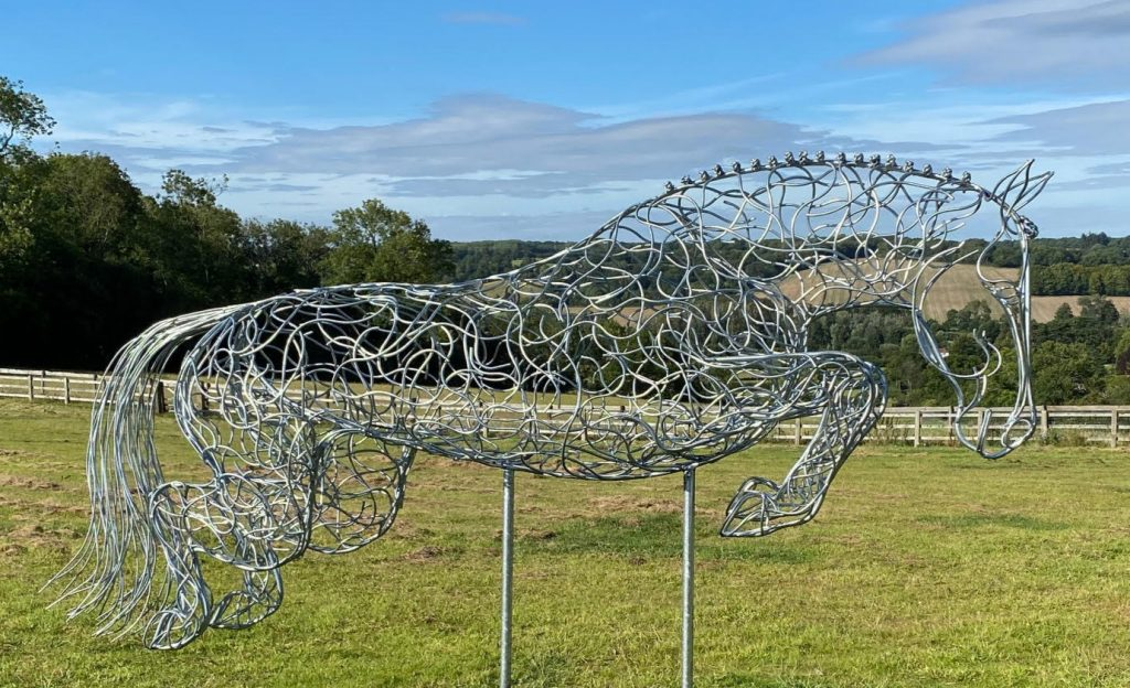 large horse jumping sculpture