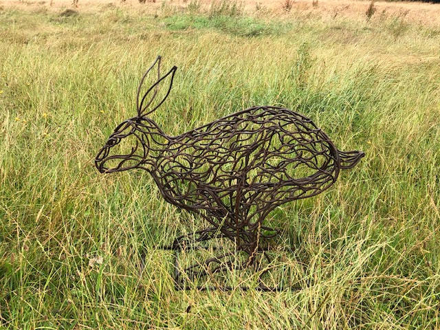small rabbit running sculpture