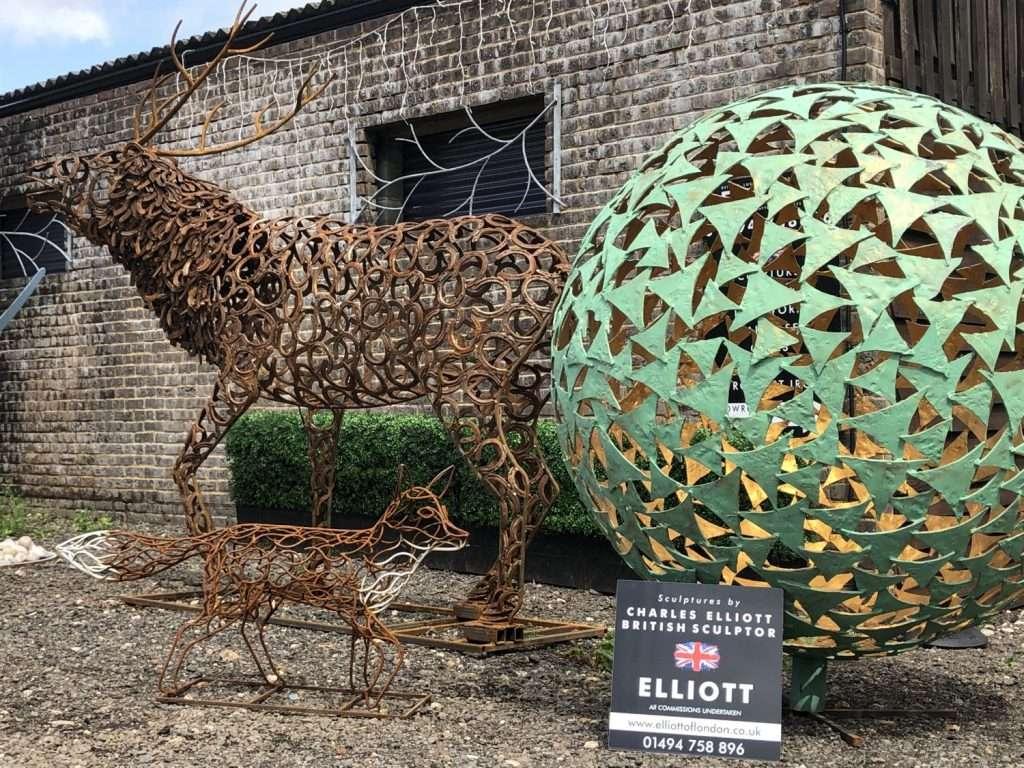 Warehouse Sculptures With Elliott Sign