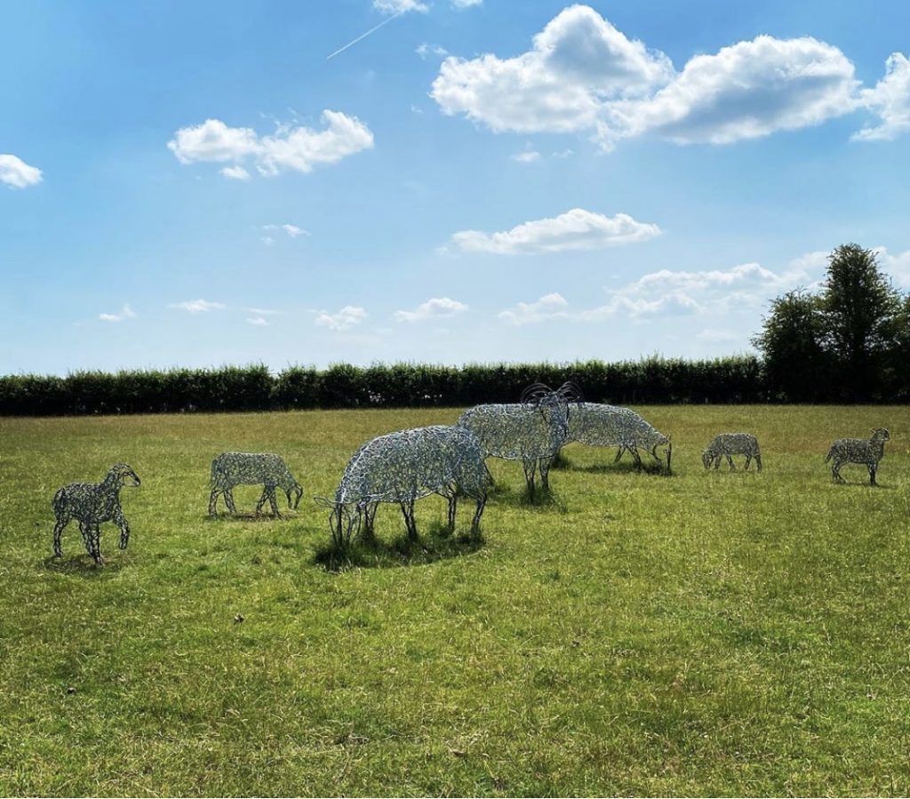 group of silver sheep sculptures