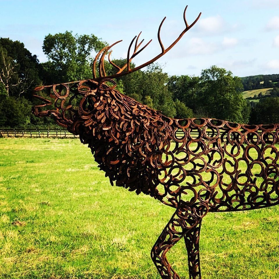 singular large stag sculpture on a sunny day