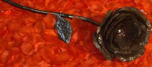 Handmade Copper Rose on red rose petals