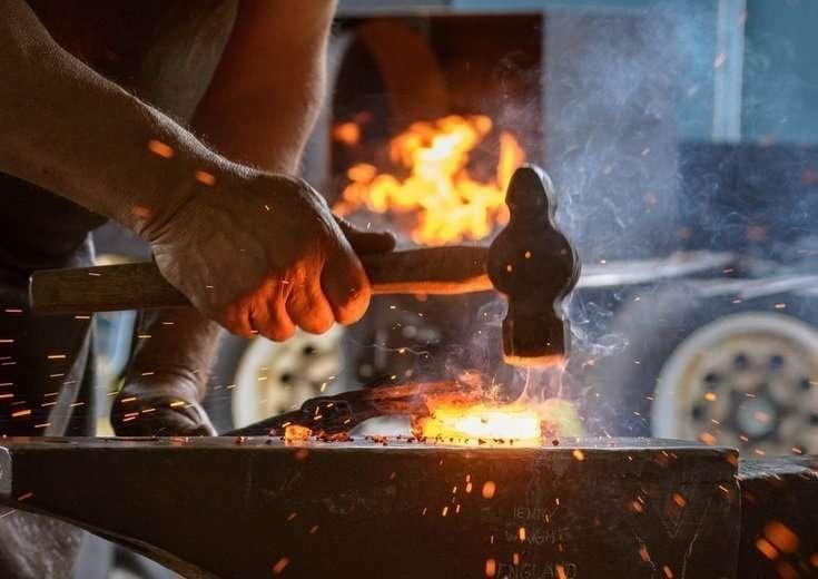 Image of a blacksmith hammering metal