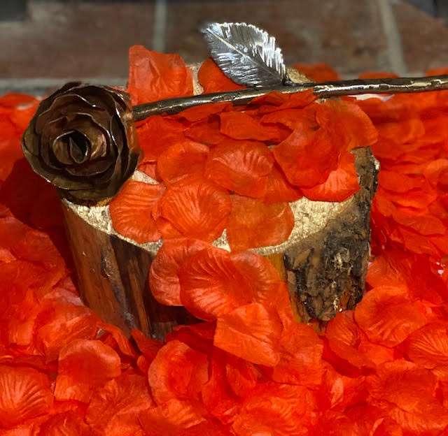 Handmade Copper Rose on flower petals