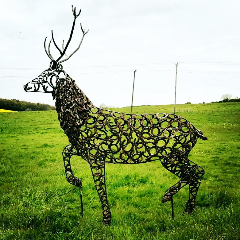 Stag Running In Field