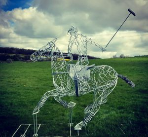 large playing polo sculpture